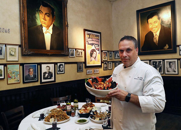 Photo of Glenn Rolnick with italian food